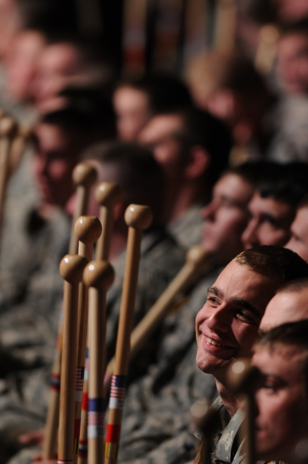 Members of the Bravo Company, 3rd Battalion, 172nd Mountain Infantry watch their fellow soldiers receive walking sticks from Galen Cole at the Collins Center for the Arts on Friday, January 7, 2011 during the Maine Army National Guard's Freedon Salute.