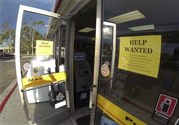 A help wanted sign is posted on the door of a gas station in Encinitas, California September 6, 2013. The U.S. government on Friday released a report on employment that showed weaker-than-expected hiring and a drop in the jobless rate as many Americans gave up the hunt for work.
