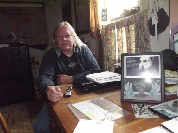 Bill Torrey of Cherryfield sits with some of the material he has received from his pen pals Charles Manson and Richard Ramirez.