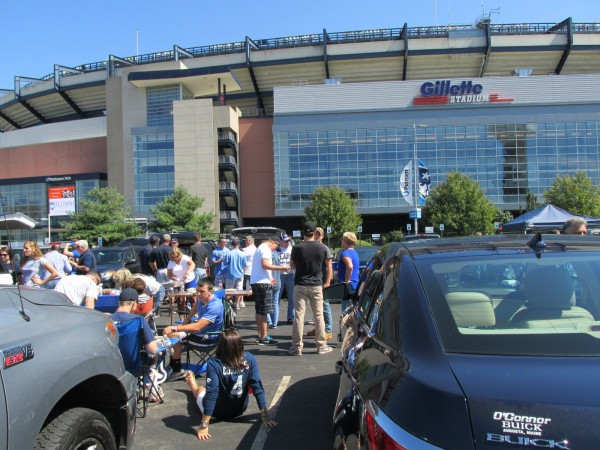 UMaine football fans enjoy food, drink and games Saturday prior to the Black Bears' game against Massachusetts at Gillette Stadium in Foxborough, Mass.