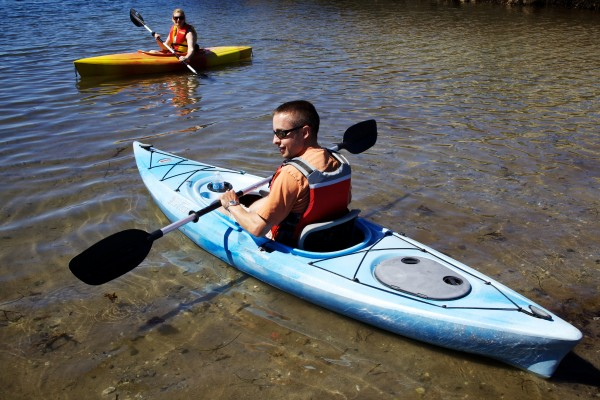 Matt and Heather Hussey of Fairfield launch their kayaks on Hendricks Head Beach in Southport in August.