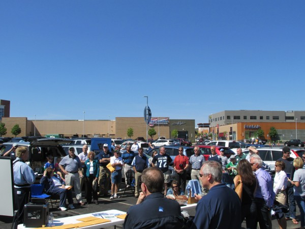 A group of fans gathers Saturday as the University of Maine celebrated the 48th anniversary of its 1965 Tangerine Bowl team prior to the game against UMass at Gillette Stadium.