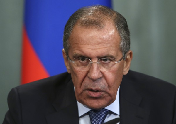 Russian Foreign Minister Sergei Lavrov speaks during a news conference following his meeting with his Egyptian counterpart Nabil Fahmy in Moscow September 16, 2013. Lavrov said on Monday it may be time to consider efforts to force foes of Syrian President Bashar al-Assad to attend an international peace conference instead of just urging them to do so.