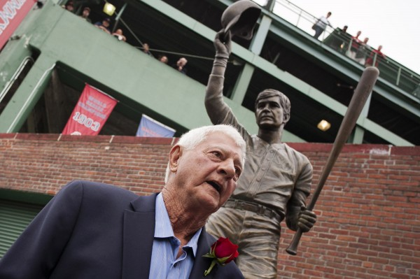 Former Boston Red Sox player and Hall-of-Famer Carl Yastrzemski is honored with a statue outside Fenway Park's Gate B in Boston Sunday.