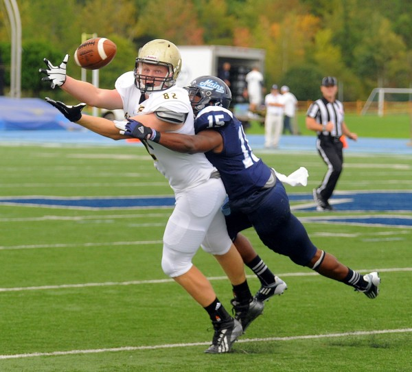 University of Maine's Jamal Clay interferes with a reception attempt by Bryant's John Lavin (left) during the first quarter of Saturday's game in Orono.