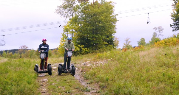 Meghan Price, (left) Segway guide and office manager, Sugarloaf Outpost Adventure Center and Ethan Austin, Sugarloaf Communications Manager demonstrate the Segway tour at Sugarloaf resort.
