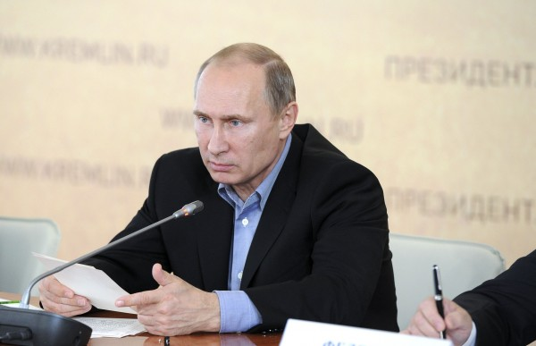 Russia's President Vladimir Putin chairs a meeting on crop harvesting as he visits the agrarian holding &quotKuban&quot in Ust-Labinsky District of the Krasnodar Territory in southern Russia, September 17, 2013.