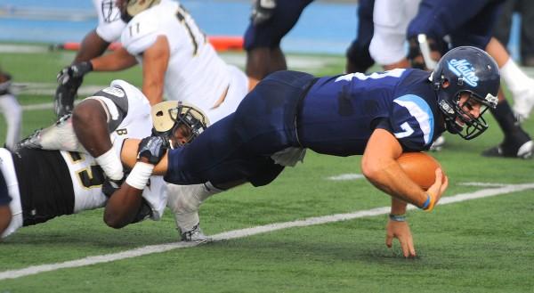 Bryant's Sebastian Amedee (left) tackles University of Maine's quarterback Marcus Wasilewski during the first quarter Saturday in Orono.