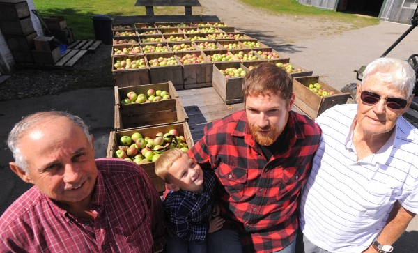 Four generations at the Conant Orchards in Etna. The orchard was started by Alphonso Conant in 1945 and has been in the family ever since. Currently it is owned by Clint Parsons (second from right), but before him, his father, Michael Parsons (left), and his grandfather, Vincent Conant (right), owned the family farm.  They grow 19 varieties of apples and sell cider, pumpkins and pears, just to name few of the items available at the farm's store. Also pictured is Clint's son, 3-year-old Ethan Michael Parsons.