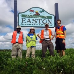 Dr. Narayana Prasanna, Lil Costello, Larry Berz and Grier Ostermann approach the 35-mile mark in Easton on their 50-mile hike from Littleton to Limestone Aug. 31 honoring the 50th anniversary of John F. Kennedy's call for national fitness and vigor.