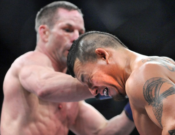 """Waachiim Spiritwolf grimaces after being hit by Bangor's Marcus Davis during the first round of a Bellator MMA fight in March in Lewiston. Davis will fight another Bellator bout Friday night in Portland, Ore., against Alexander """"Tiger"""" Sarnavskiy."""