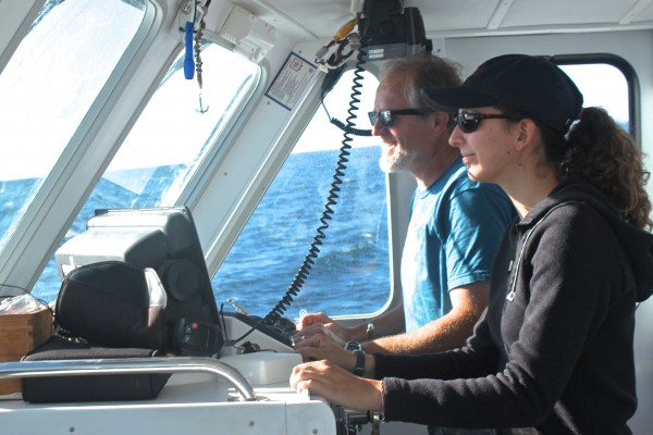 "College of the Atlantic Capt. Toby Stephenson and COA senior Rachel Sullivan-Lord search for whales while leading an ""old school"" whale watching tour aboard the COA research boat Osprey on Sept. 19, 2013. COA emphasizes hands-on, project-oriented learning."