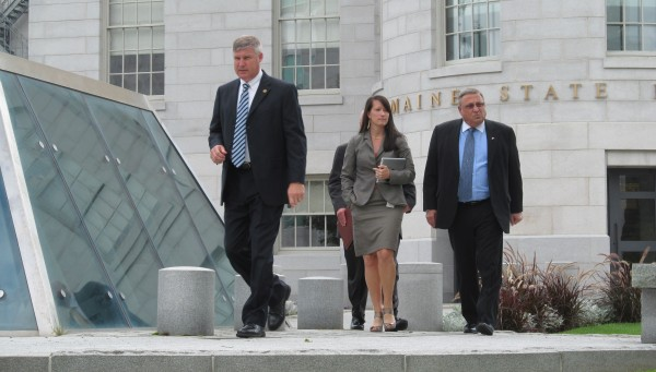 Gov. Paul LePage, right, exits the State House on Aug.14, with Press Secretary Adrienne Bennett and other members of the executive staff.