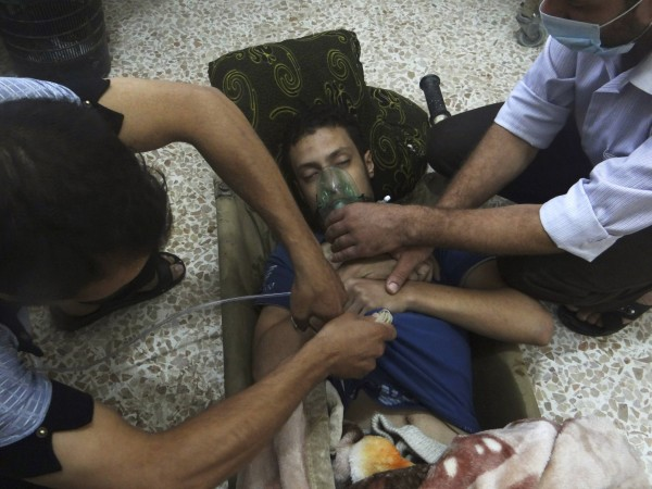 A man, affected by what activists say is nerve gas, breathes through an oxygen mask in the Damascus suburbs of Jesreen in this August 21, 2013 file photo. A report by U.N. chemical weapons experts will likely confirm that poison gas was used in an August 21 attack on Damascus suburbs that killed hundreds of people, U.N. Secretary-General Ban Ki-moon said on September 13, 2013. France's U.N. ambassador, Gerard Araud, told reporters that September 16, 2013 is the tentative date for Ban to present Sellstrom's report to the Security Council and other U.N. member states.