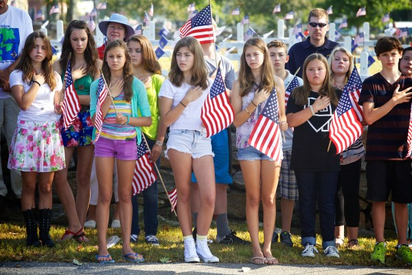 Freeport Middle School students listen to the Star Spangled Banner at a ceremony Wednesday morning marking the anniversary of Sept. 11, 2001 in Freeport. They're too young to remember the original event and some are currently studying it in school.
