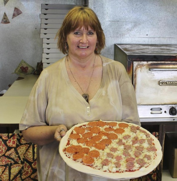 Pam Ames shows off one of her specials at Shiretown Pizza and Sandwich Shop in Dover-Foxcroft.