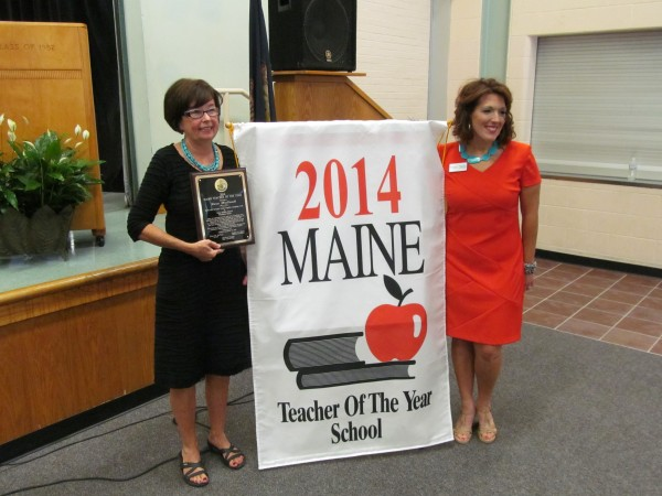 Karen MacDonald, left, a teacher at King Middle School, poses with Shannon Shanning after MacDonald was named Maine's 2014 Teacher of the Year Tuesday morning in a ceremony at the Portland school. Shanning, who teaches in Poland, was the 2013 Teacher of the Year.