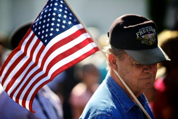 George Briggs of Freeport holds a flag while attending a ceremony Wednesday morning marking the anniversary of Sept. 11, 2001, in Freeport.