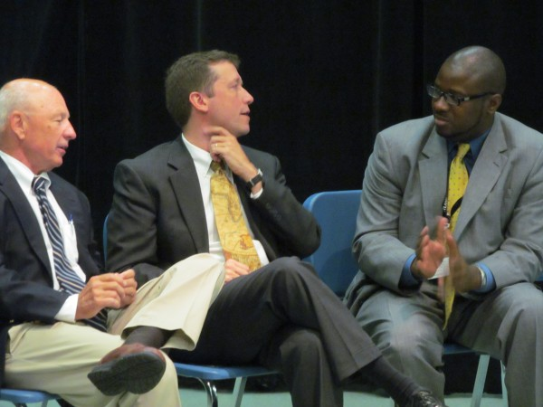 Portland Mayor Michael Brennan, left, chats with Maine Education Commissioner Stephen Bowen and Portland Public Schools Superintendent Emmanuel Caulk after Portland middle school teacher Karen MacDonald was named the state's 2014 Teacher of the Year in a Tuesday morning ceremony at King Middle School.