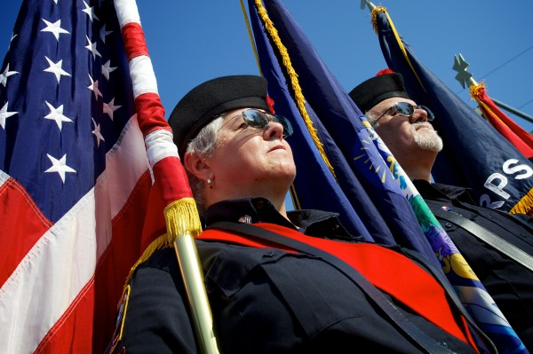 Irene LeClaire and Carl Paradis of the Maine Public Safety Pipe and Drum Corps act as color guards at a ceremony Wednesday morning marking the anniversary of Sept. 11, 2001, in Freeport.