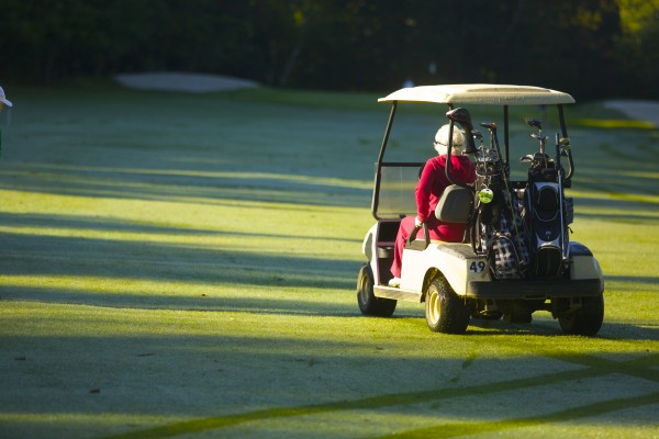 Hilda Wardwell, 90, drives a golf cart toward the putting green last week at the Bangor Municpal Golf Course.