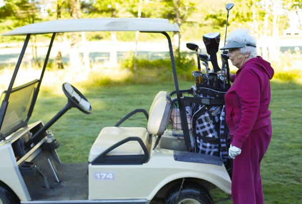 Hilda Wardwell, 90, pulls out one of her irons last week at the Bangor Municipal Golf Course.