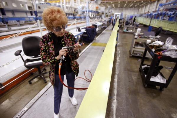 Wing mechanic Elinor Otto, 93, prepares to rivet a wing while working at Boeing in Long Beach, California, August 28, 2013. Otto, who lives in Long Beach, is believed to be the oldest &quotRosie the Riveter&quot in the local area.