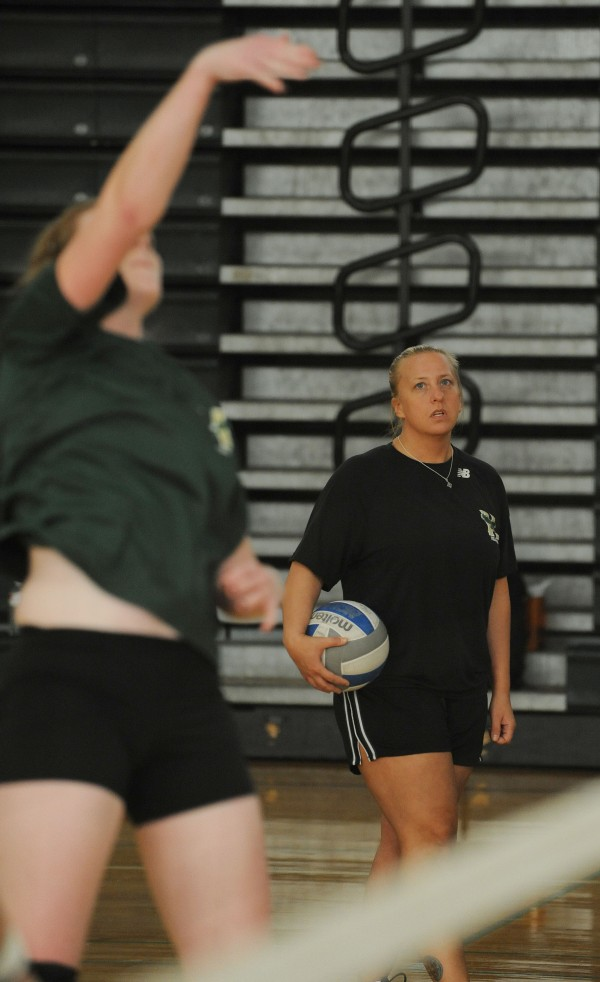 Husson volleyball coach Jodie Fairbank coaches her team during a practice at Husson University on Monday.