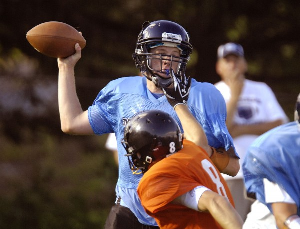 Sam Meklin of Oceanside High school looks for an open receiver during a preseason scrimmage against Brewer in 2011.