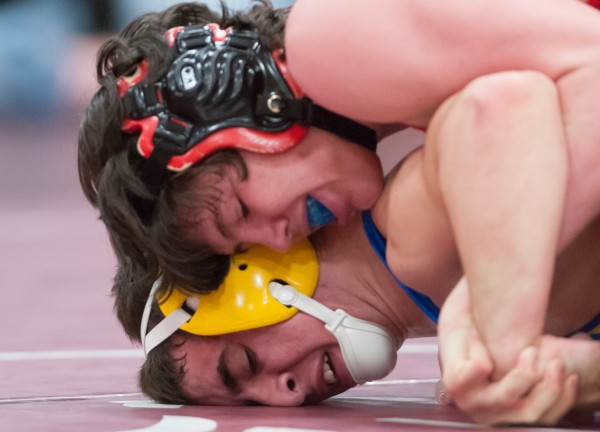 Camden Hills Regional High School's Coleman Powers (top) wrestles against Belfast Area High School's Michael McFadden (bottom) in the 145-pound championship match at the Eastern Maine Class B wrestling regional tournament in February.