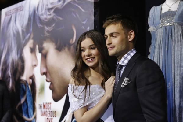 Cast members Douglas Booth, right, and Hailee Steinfeld pose at the premiere of &quotRomeo and Juliet&quot in Los Angeles, California September 24, 2013.