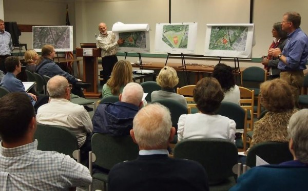 Architect Scott Simons discusses conceptual designs for the expansion and renovation of Falmouth Memorial Library on Tuesday in the Russell Room of the library.