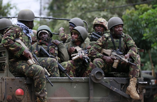 Soldiers from the Kenya Defence Forces arrive at the Westgate Shopping Center in the capital Nairobi on Sept. 22, 2013. Kenyan security forces were locked in a stand-off on Sunday with gunmen who killed at least 68 people at the upscale  shopping mall in the Kenyan capital. The KDF freed the hostages in a late night operation, officials said.