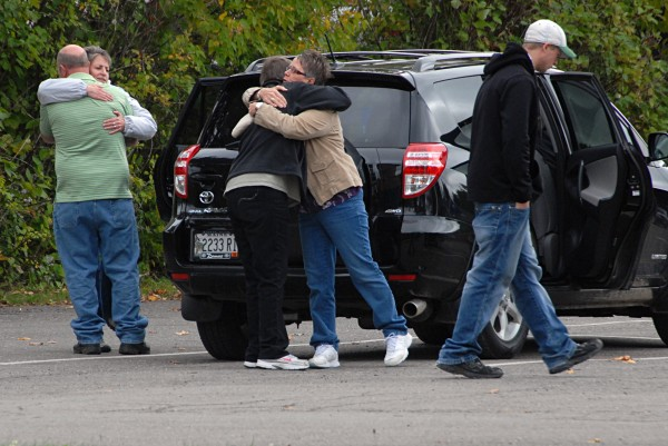 People believed to be members of the families involved with the Matthew Davis court case hug outside of Houlton Superior Court on Wednesday, Sept. 25, 2013.