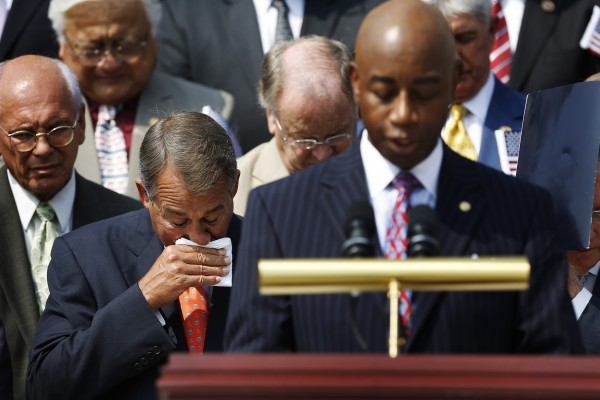 U.S. House Speaker John Boehner (R-OH) (L) wipes away tears after speaking at a remembrance of lives lost in the 9/11 attacks, at the U.S. Capitol in Washington, September 11, 2013. Bagpipes, bells and a reading of the names of the nearly 3,000 people killed when hijacked jetliners crashed into the World Trade Center, the Pentagon and a Pennsylvania field marked the 12th anniversary of the September 11 attacks in 2001.