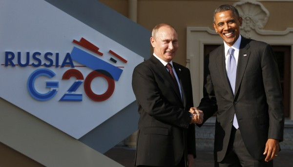 Russia's President Vladimir Putin (L) welcomes U.S. President Barack Obama before the first working session of the G20 Summit in Constantine Palace in Strelna near St. Petersburg, September 5, 2013.