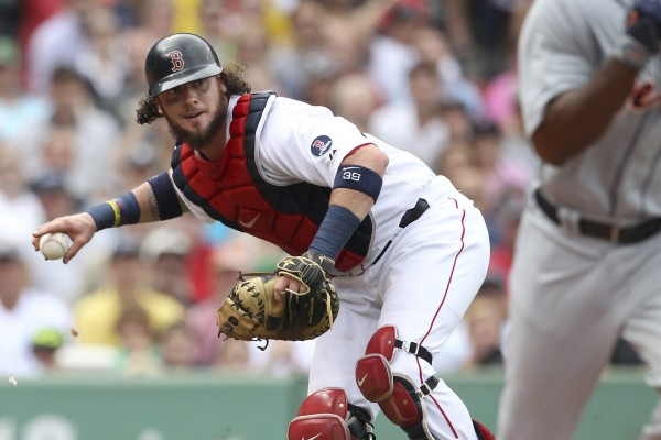 Boston Red Sox catcher Jarrod Saltalamacchia fields the ball against the Detroit Tigers in the third inning Monday in Boston.