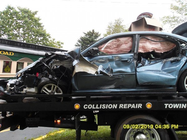 A Subaru Legacy sedan was totaled Monday afternoon after driver Gabriella Just failed to see the oncoming Downeast Scenic Railroad train coming at her on Davis Street. Just escaped with minor injuries, police said.