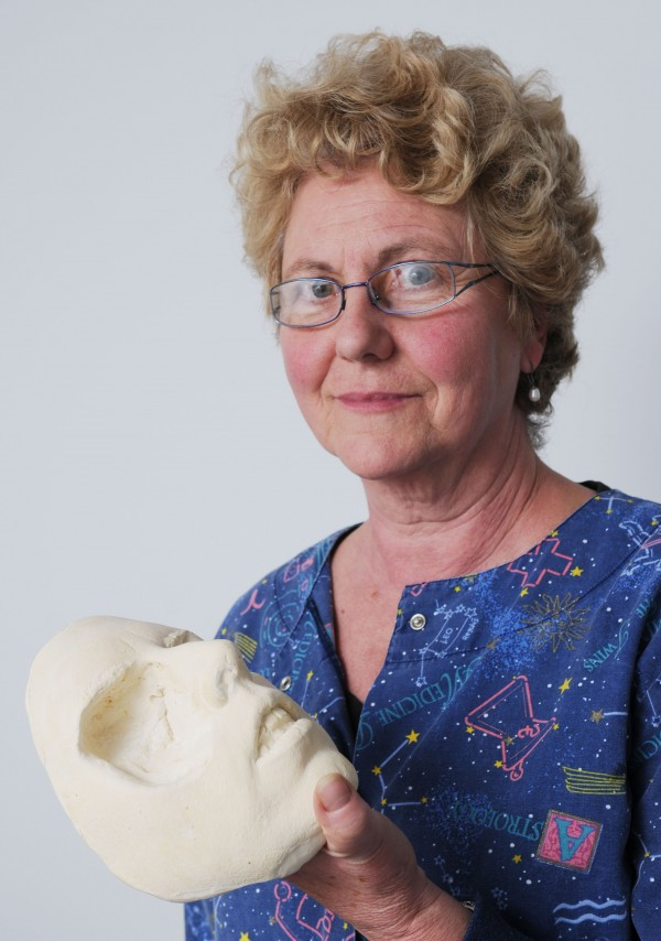 Ocularist and anaplastologist Ottie Thomas-Smith poses with one of the facial molds she has made to produce a prosthetic for a patient at her Jackson office. Ottie Thomas-Smith considers herself an artist and loves to help people who have lost an eye, ear, nose or more.