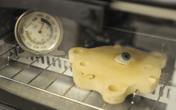 A prosthetic eye is heated in a toaster oven to cure the multiple layers of color in the iris. Ottie Thomas-Smith creates prosthetic eyes, ears, noses and more of almost 200 people a year out of her Jackson office.