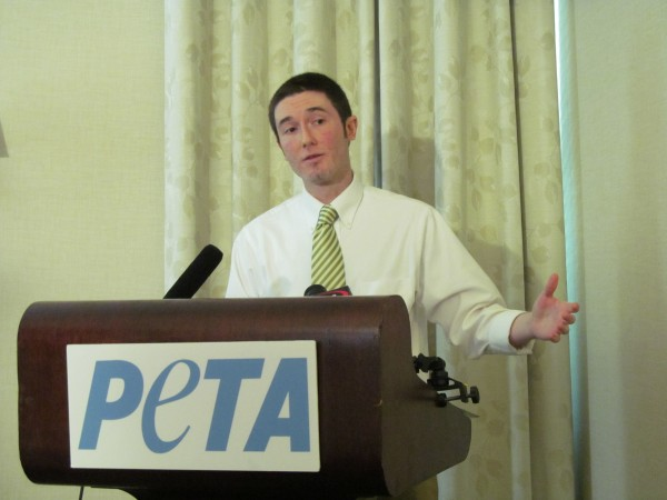 Dan Paden, a research associate with the People for the Ethical Treatment of Animals, tells reporters at a Portland news conference Tuesday that his organization sent an operative into a Rockland lobster processing facility with a hidden camera to document the inhumane treatment of the crustaceans.