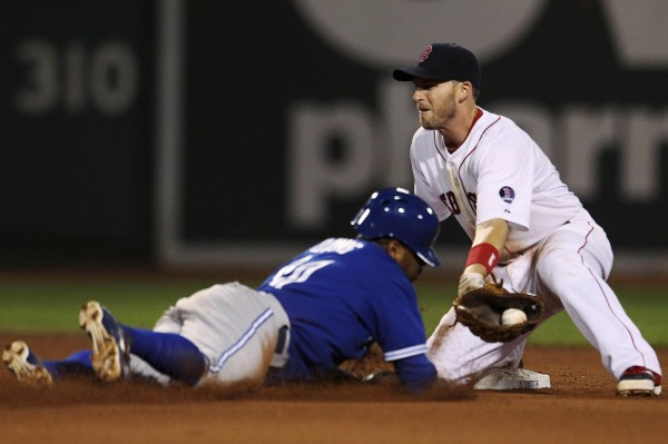 Toronto's Rajai Davis is caught stealing by Boston Red Sox shortstop Stephen Drew in the sixth inning in Boston Saturday night.