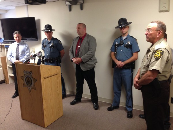 Penobscot County Sheriff Glenn Ross (right) held a press conference to announce the charges brought against Benjamin Sprague, Chester Birmingham and Donald Getchell Jr., the suspects in a robbery in Orrington and an attempted robbery at Bob's Kozy Korner Store in Orrington. Birmingham and Getchell Jr. were also charged with a robbery at a Glenburn convenience store.