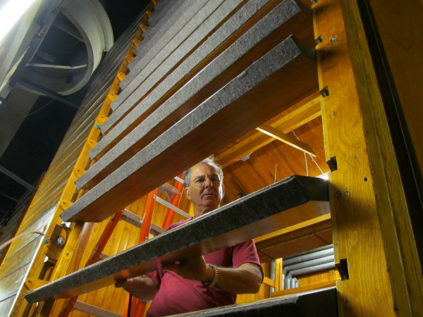 Phil Carpenter of restoration firm Foley-Baker Inc., turns sound dampening panels by hand inside Portland's century-old Kotzschmar Organ, which his company is in the middle of restoring. When the instrument is fully assembled, the organist can flip the panels using a foot pedal.