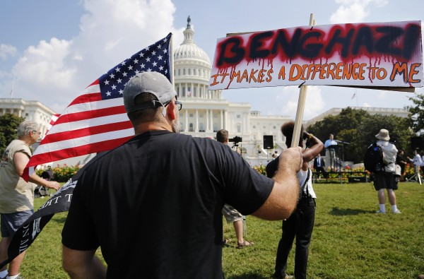 A small group of protesters rally to protest against the U.S. government's response to the deaths of four Americans during an Islamist militant attack on a U.S. diplomatic compound in Benghazi, Libya, last year, on the West Lawn of the U.S. Capitol in Washington, September 11, 2013.