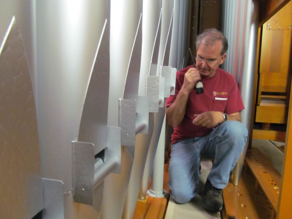 Phil Carpenter, project manager with Foley-Baker Inc., radios to a coworker to test out a few of the historic Kotzschmar Organ's nearly 7,000 pipes. Many of the organ pipes have been repaired and reinstalled as part of a $2.5 million renovation project.