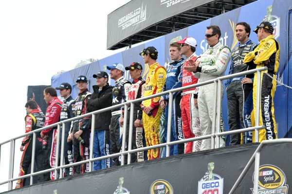 NASCAR Sprint Cup Series drivers in the Chase (from left to right) Jeff Gordon (24), Ryan Newman (39), Kasey Kahne (5), Kurt Busch (78), Dale Earnhardt Jr. (88), Clint Bowyer (15), Greg Biffle (16), Joey Logano (22), Carl Edwards (99), Kevin Harvick (29), Kyle Busch (18), Jimmie Johnson (48), and Matt Kenseth (20) before the Geico 400 at Chicagoland Speedway.