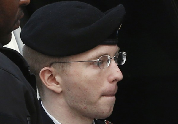 U.S. soldier Chelsea Manning, formerly Bradley, is escorted into court to receive his sentence at Fort Meade in Maryland August 21, 2013. Manning, who was convicted of the biggest breach of classified data in the nation's history, was sentenced to 35 years in a military prison.