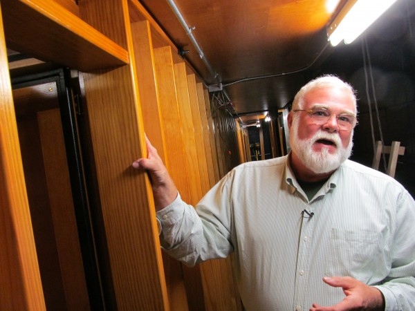 John Bishop, chairman of the Friends of the Kotzschmar Organ's organ committee, says that moving around the insides of the massive musical instrument is like navigating through a submarine, complete with an airlock passageway leading into the windchest.