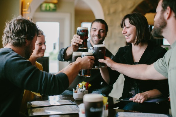 Portland photographer Emily Delamater, second from left, joins brother-in-law Erik Person, husband Matthew Delamater, sister Jessica Person and brother-in-law Jesse Hill for a toast while on a trip to Ireland in July.
